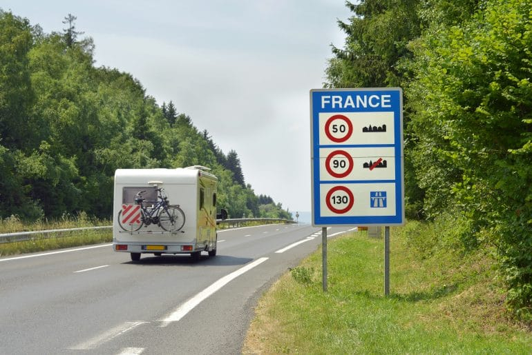 Camper,Passing,The,Sign,Of,Speed,Limits,At,The,French